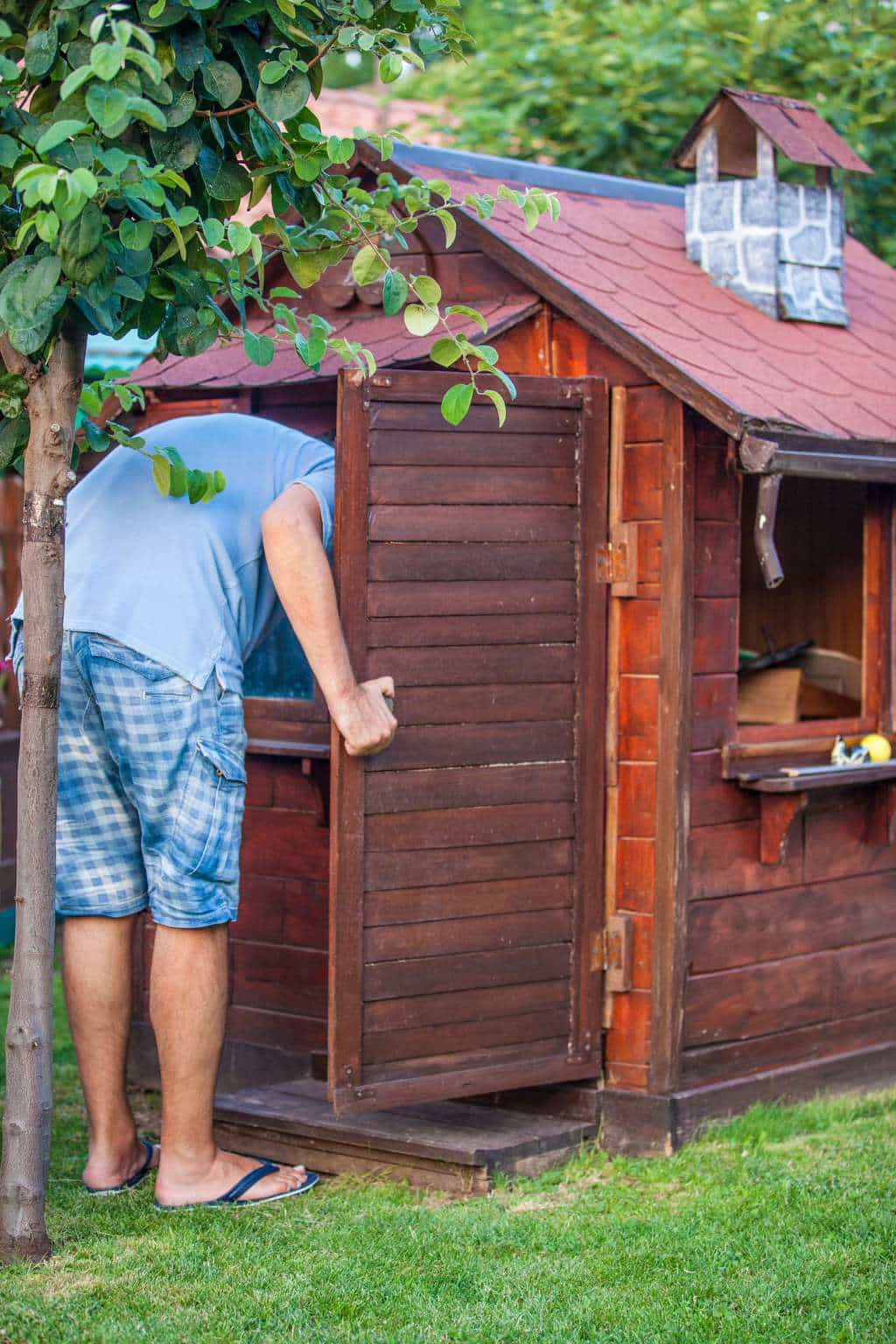 Man looking into playhouse