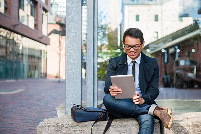 Young business man using Acorio's ServiceNow's HR Service Management software