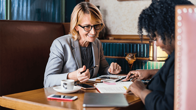 Organizational change management meeting 2 women