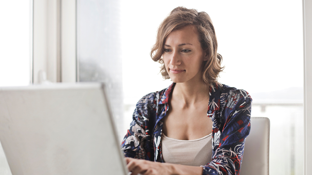 Woman working remotely on laptop