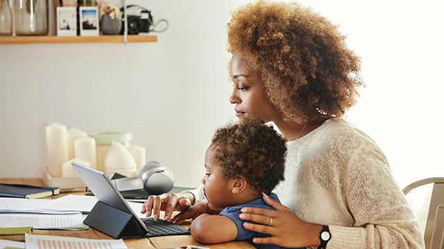 ServiceNow Emergency Relief App Blog Cover, Mother Working From Home with Child